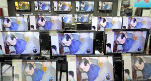 張成沢の粛清のニュースを伝える韓国のテレビ=2013年12月、AP