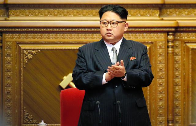 9日、朝鮮労働党大会に臨む金正恩氏=AP