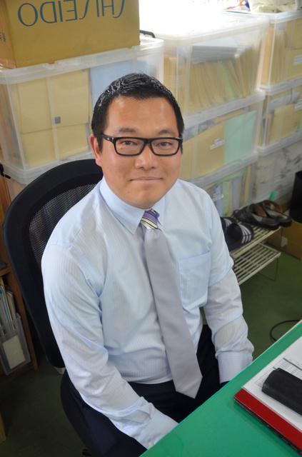 「人間の力を信じています」と川村拓也さん=横浜市港北区のサンパワー本社