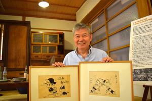 お休み処に再現したトキワ荘の室内。鷲田和彦さんは石ノ森章太郎(左)、赤塚不二夫のサインを今も大事にしている=東京都豊島区