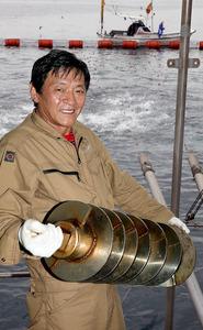 中島有四郎さん つくった餌やり機の部品、1000機分以上