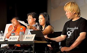 登壇した津田大介さん、親川志奈子さん、熊本博之さん、東浩紀さん(右から)=5月27日、那覇市の桜坂劇場