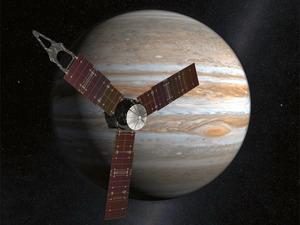 木星に近づく探査機ジュノーの想像図(NASA提供)