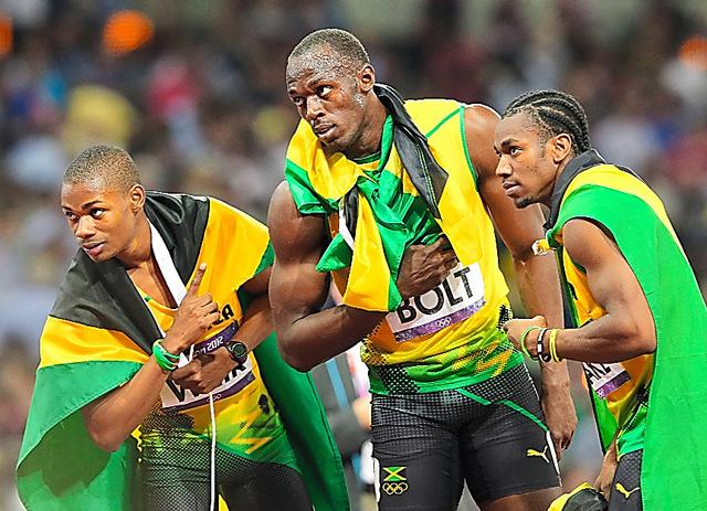 2012年のロンドン五輪の陸上男子200メートルで優勝したボルト(中央)らジャマイカ勢。国際共同研究「アスローム」ではジャマイカの短距離選手のDNAも調べる