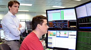 超高速取引(HFT)を手がける会社のトレーディングルーム。日本株も取引している=8月、シンガポール、神山純一撮影