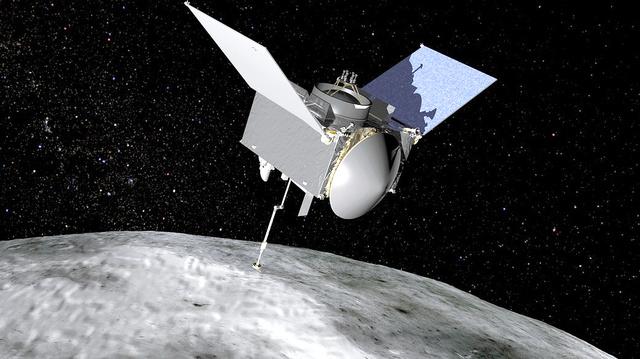 小惑星ベンヌの表面から試料を採取する探査機「オシリス・レックス」のイメージ=米航空宇宙局(NASA)提供