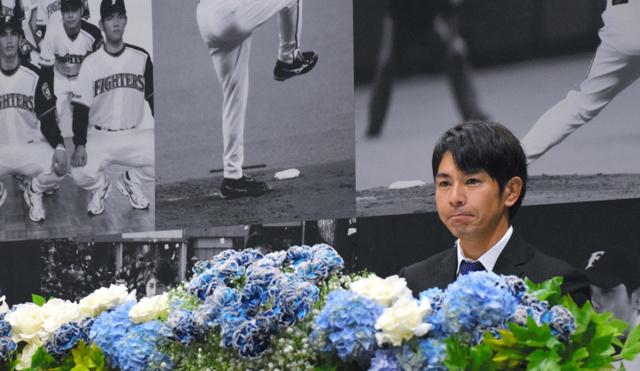 会見で引退を表明した武田勝=札幌ドーム