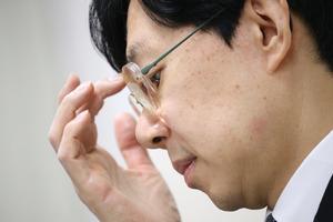 会見で辞任の意向を表明した日本将棋連盟の谷川浩司会長=18日午後3時13分、東京都渋谷区、時津剛撮影