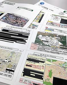 公表された日報には黒塗りが目立つ。部隊の警備に関わる情報や他国から得た情報の部分を伏せたという=東京・市谷の防衛省