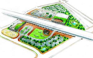 飯田市が公表したリニア駅イメージ図。中央を横断する駅舎の上部(北)と下部(南)にバスなどの乗降場や駐車場、広場などが配置されている