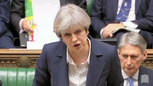 英議会で29日、答弁に立つメイ首相=AFP時事