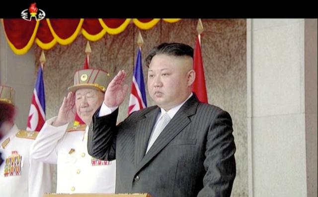 金日成主席生誕105周年の15日、北朝鮮の平壌であった軍事パレードに出席した金正恩朝鮮労働党委員長(朝鮮中央テレビの映像から)=AP