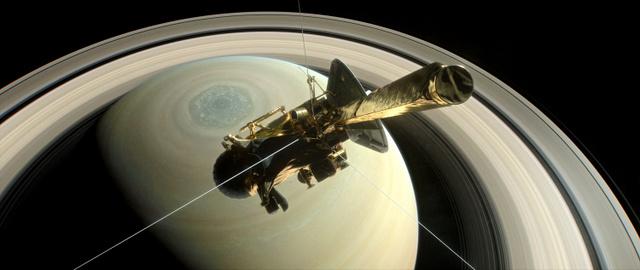 土星の近くを通過する探査機カッシーニの想像図(NASA提供)