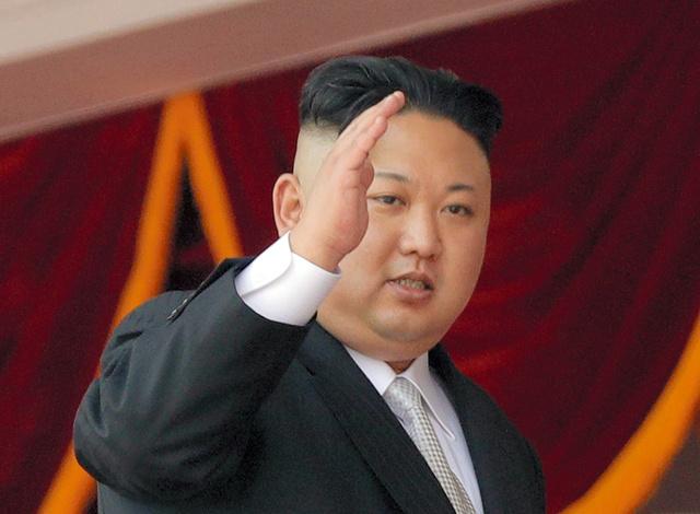 平壌で15日、故金日成国家主席の生誕105周年を祝う軍事パレードに出席した金正恩・朝鮮労働党委員長=AP
