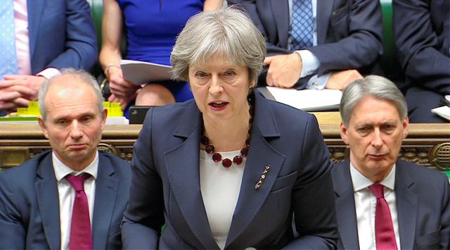 14日、ロシアの元スパイらに対する殺人未遂事件への対応について下院で演説する英国のメイ首相(国会テレビ提供)=ロイター