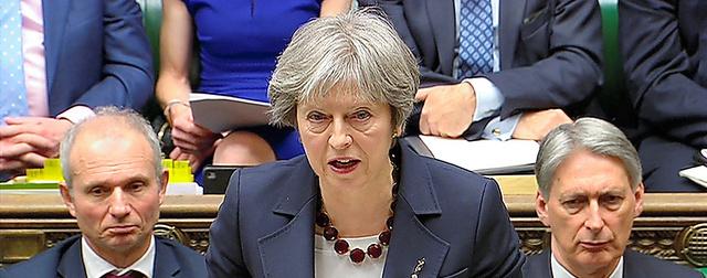 14日、下院で演説する英国のメイ首相(国会テレビ提供)=ロイター