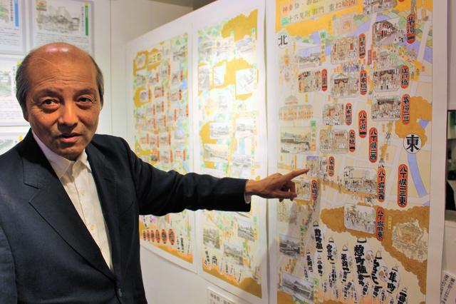 山王祭と江戸城を描いた作品について説明する木下栄三さん=2018年5月21日、東京都中央区銀座4丁目の銀座煉瓦画廊