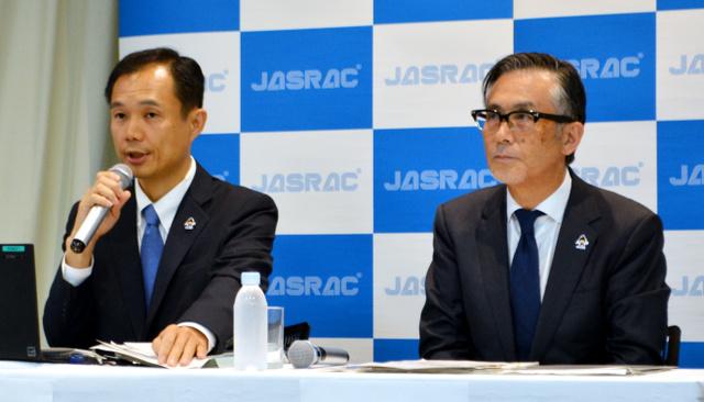 外国映画の音楽使用料について映画館側と合意したことを発表するJASRACの世古和博常務理事(右)ら=2018年9月6日午後3時5分、東京都港区