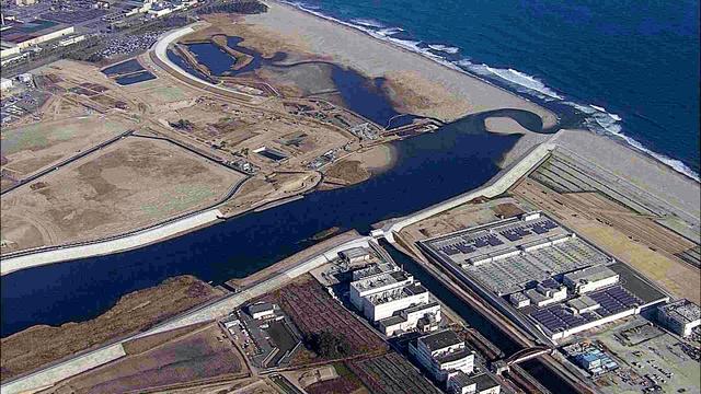 現在の蒲生。七北田川(中央)から北(左上)の貞山堀は埋め立てられ、さらに集落が消え、造成地になっている=2018年11月28日、東日本放送提供