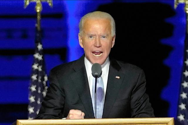 7日、米デラウェア州ウィルミントンで演説するバイデン次期大統領=AP
