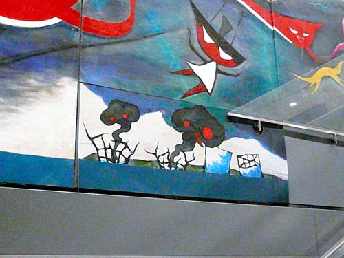 写真:岡本太郎の壁画「明日の神話」の余白部分に張り付けられたチン↑ポムの作品=5月1日、東京・渋谷駅、岡本太郎記念館提供