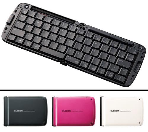 写真:画像2:エレコムが9月に発売したAndroid端末向けキーボード「TK—FBP018」(実勢価格1万2800円<税込み>)。外側のケースの色の違いで、黒(BK)、ピンク(PN)、白(WH)の3色がある。キー配列は日本語。英語配列の同019Eもある。単4乾電池2本で動作
