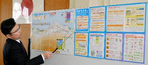 写真:黒部市防災会議で披露された市津波ハザードマップ=同市役所