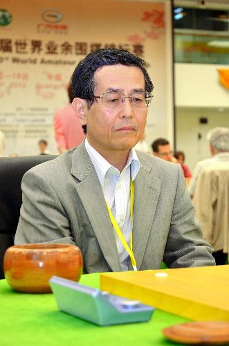 写真:世界アマ選手権に臨む日本代表の中園清三選手=14日、中国広州市の広州棋院、日本棋院提供