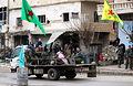 アレッポ北部にあるクルド人支配地域との境界線では、シリアのクルド人武装組織「YPG」の旗を掲げたクルド兵たちが警備にあたっていた=9日午後、アレッポ、矢木隆晴撮影