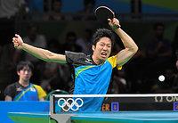 男子団体準決勝の第4試合で、ショットを放つ水谷隼=竹花徹朗撮影