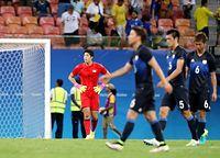 ナイジェリアに敗れ、肩を落とすGK櫛引ら日本の選手たち=4日、ブラジル・マナウス、長島一浩撮影