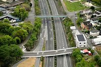 高速道路の上に架かる橋が落下していた=16日午後2時53分、熊本県甲佐町の九州道緑川PA付近、朝日新聞社ヘリから、白井伸洋撮影