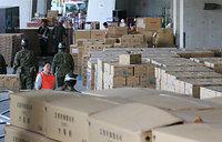 陸上競技場の敷地には、全国から届いた物資が積み上がっていた=17日午後、熊本市東区、細川卓撮影