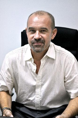 写真:チェルノブイリ原発事故後の作業について語るベリヤコフさん=シンガポール、塚本写す
