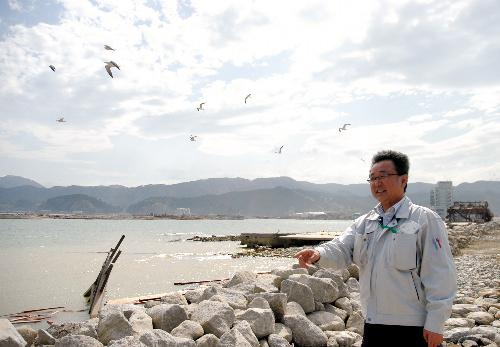 写真:「何年かかっても、美しい高田の海を取り戻すのが生き残った私たちの務め」と金賢治さん=岩手県陸前高田市