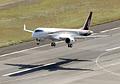 県営名古屋空港を離陸するMRJ=11日午前9時35分、代表撮影