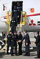 初飛行を終え、出迎えた関係者と握手を交わすMRJの乗務員=11日午前11時40分、愛知県営名古屋空港、細川卓撮影