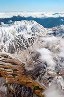 初冠雪した立山連峰=2014年10月7日、富山県立山町、朝日新聞社ヘリから、橋本弦撮影