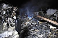 地震後の火災で焼失した家屋=15日午前1時36分、熊本県益城町安永、福岡亜純撮影