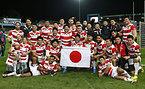 勝利に喜ぶ日本の選手たち=ロイター