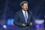 開会式でスピーチするヘンリー王子=ロイター