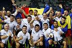 今大会、初勝利を挙げ喜ぶルーマニアの選手たち=ロイター