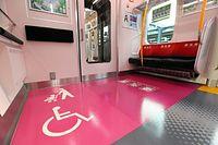 山手線の新型車両E235系に設置された優先席の表示=30日午後、東京都品川区、林敏行撮影