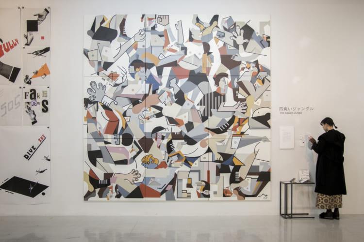 「四角いジャングル」キュビズム(様々な角度から見た対象のカタチを一つの画面に収める方法)を使い、プロレスを等身大で描いた作品。3.5m×3.5mのアクリル画。