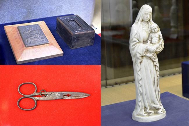 マリア観音像や踏み絵、踏箱、閉じるとクルスが現れるハサミなど、信仰の歴史を伝える貴重な品が並ぶ