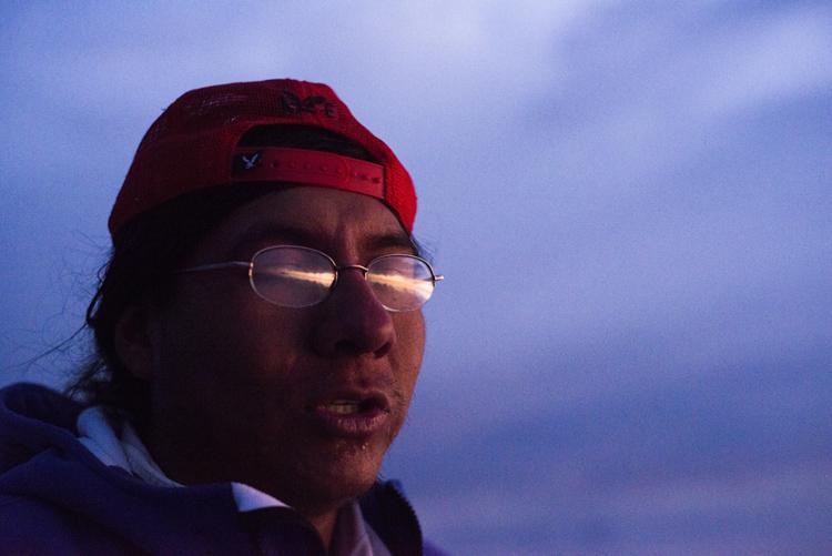 メガネに映るウユニ塩湖の夕日