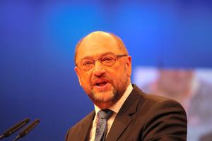 ドイツ社民党、メルケル与党と連...