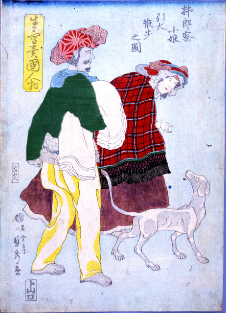洋犬を散歩させるフランスの女性