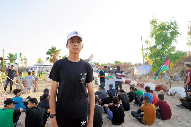 イスラム組織ハマスの軍事部門が主催するキャンプに参加するアブドラさん=2021年7月11日、パレスチナ自治区ガザ地区、清宮涼撮影